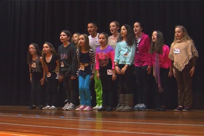 Area students work with one of original cast members of Broadway show, Wicked_-8620954868579873835